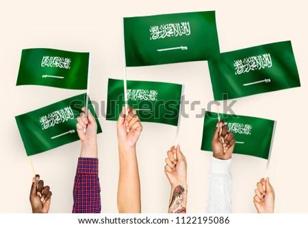 Hands waving the flags of Saudi Arabia #1122195086