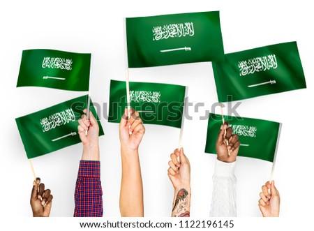 Hands waving the flags of Saudi Arabia #1122196145