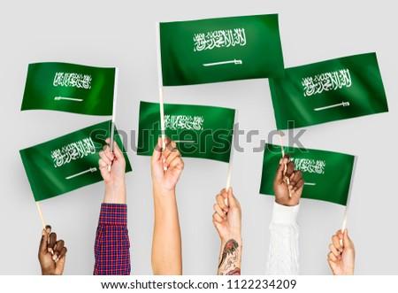 Hands waving the flags of Saudi Arabia #1122234209