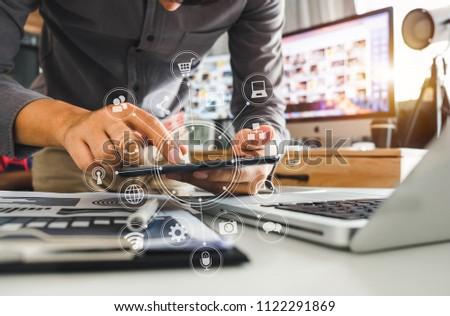 businessman hand working with laptop computer, tablet and smart phone in modern office with virtual icon diagram at modern office in morning light   #1122291869