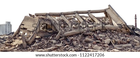 Collapsed concrete industrial building isolated on white with dramatic sky and factory chimney and another concrete building in background. Disaster scene full of debris, dust and damaged house. Royalty-Free Stock Photo #1122417206