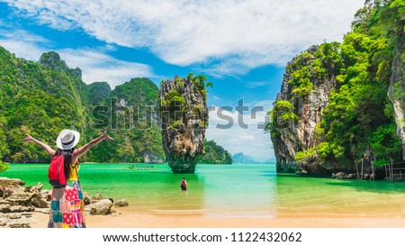 Panorama scenery amazing nature landscape with traveler woman look and joy view James Bond island, Water travel Phuket Thailand, Tourism beautiful destination place Asia, Summer holiday vacation trip #1122432062