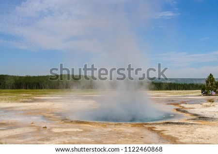 A smoking Geyser in the Norris Geyser Basin Area in Yellowstone National Park #1122460868