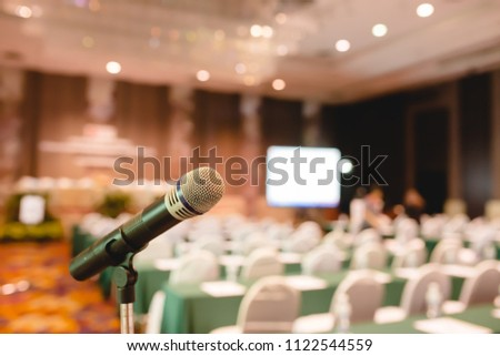 Microphone in an auditorium for shareholders' meeting or seminar event. #1122544559