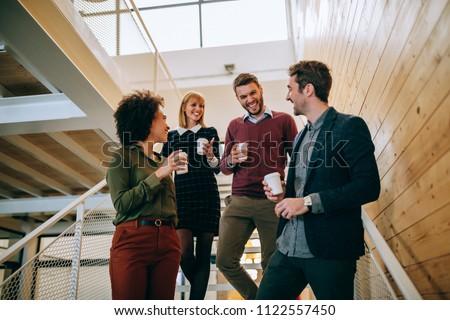 Group of coworkers having a coffee break #1122557450