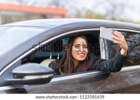 A young girl is taking a selfie #1122581639