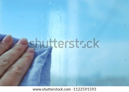 Sunscreen. Installation of sun film on window. Cleaning and washing windows with microfiber #1122591593