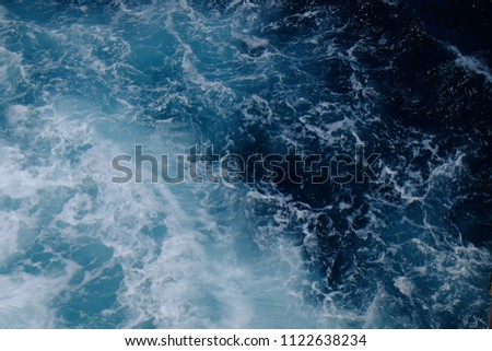 Blue sea water surface background with rainbow #1122638234