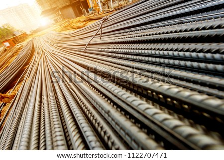 steel rebar for reinforcement concrete at construction site with house under construction background #1122707471