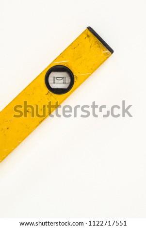 Yellow Spirit level isolated on white background. #1122717551