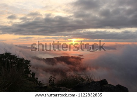 A sea of mist in the sunrise of morning with a gray cloudy #1122832835