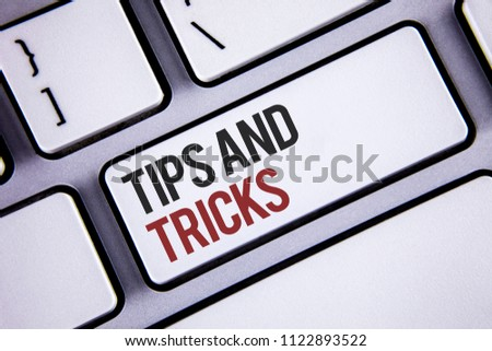 Writing note showing  Tips And Tricks. Business photo showcasing Suggestions to Make things easier Helpful Advices Solutions Keyboard gray keys black letters words Intention text on computer.