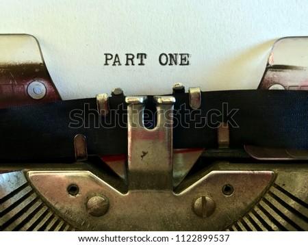 Part One, title heading of manuscript typewritten on vintage manual typewriter machine