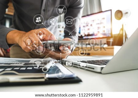 businesswoman or Designer using smart phone with laptop and digital tablet computer and document on desk in modern office with virtual interface graphic icons network diagram  #1122959891