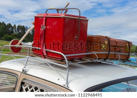 travel case on roof of oldtimer with tricycle at rural countryside south germany springtime near city stuttgart #1122968495