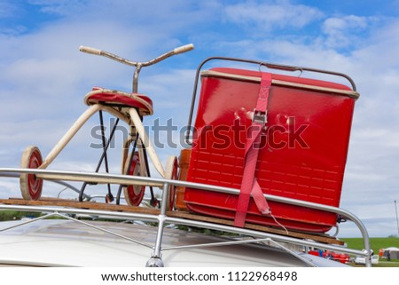 travel case on roof of oldtimer with tricycle at rural countryside south germany springtime near city stuttgart #1122968498