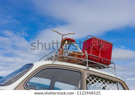 travel case on roof of oldtimer with tricycle at rural countryside south germany springtime near city stuttgart #1122968525