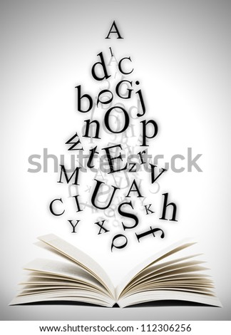 Open book with falling letters over grey background #112306256