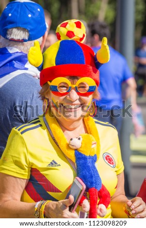 Russia, Samara, June 2018: a beautiful, elegant, national-style football fan from Colombia at the World Cup. #1123098209