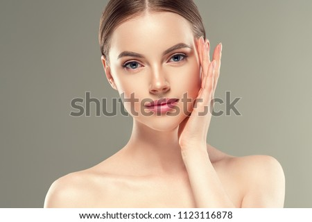 Beautiful woman female skin care healthy hair and skin close up face beauty portrait #1123116878