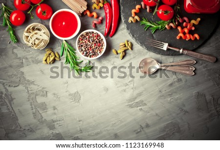 Pasta in a composition with vegetables and kitchen accessories #1123169948