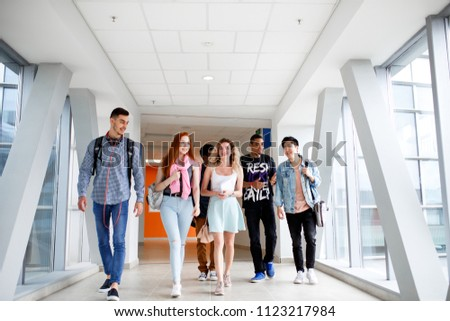 A group of young students from different countries go to classes. The photo illustrates education, College, school, or University. #1123217984