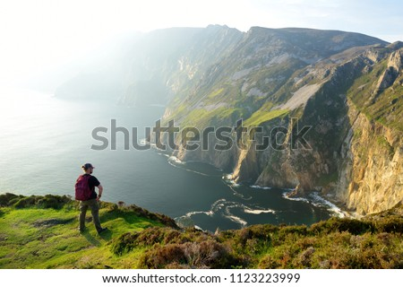 Slieve League, Irelands highest sea cliffs, located in south west Donegal along this magnificent costal driving route. One of the most popular stops at Wild Atlantic Way route, Co Donegal, Ireland. Royalty-Free Stock Photo #1123223999