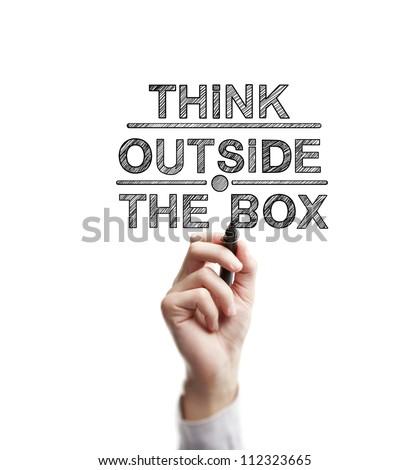 man hand draws think outside the box