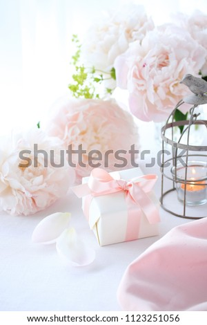 Beautiful pale pink peony flowers with small gift box #1123251056