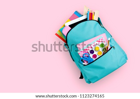 Full school backpack isolated on pink background Royalty-Free Stock Photo #1123274165