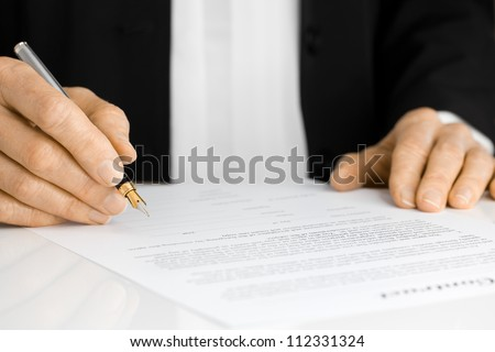 Business Person with fountain pen signing a contract #112331324