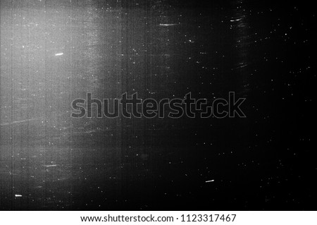 Black Dusty Background. Old Film Texture Royalty-Free Stock Photo #1123317467