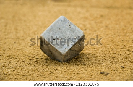 concrete cube in  sand. cube concrete sample for testing in wet sand. abstraction, conception. #1123331075