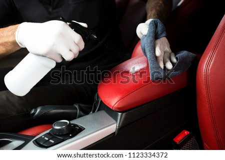 Detailing series, Cleaning red leather by use micro fiber cloth wipe chemical Royalty-Free Stock Photo #1123334372