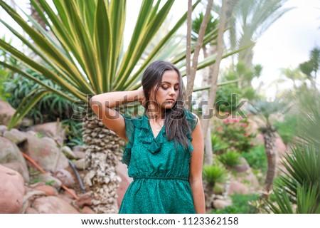 Beautiful girl in green long dress. #1123362158