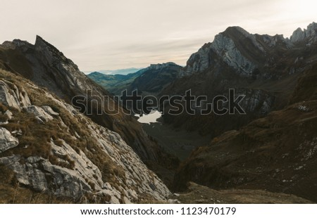 Misty mountains on a nice morning in the beautiful Alpstein in Switzerland #1123470179