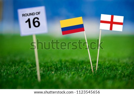 """Columbia and England national flag on green grass. White table with tittle """"ROUND OF 16"""" Round of 16, eight final, 3. July,  #1123545656"""