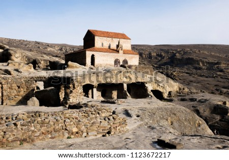 Uplistsikhe is an ancient rock-hewn town in eastern Georgia. The Uplistsikhe cave complex with a 9th/10th century three-nave basilica. #1123672217