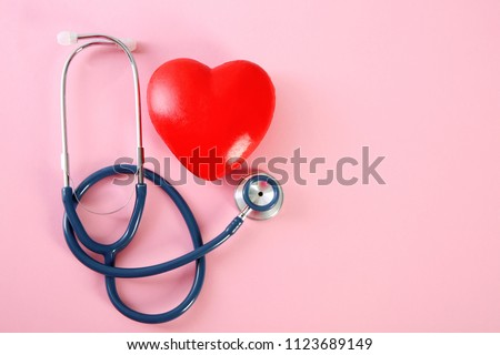 Flat lay composition with red heart model and stethoscope on color background, top view #1123689149
