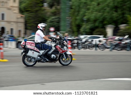 Monaco, Monaco, June 2018, A motorcycle policeman on duty in the city #1123701821