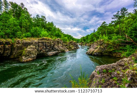 Mountain forest river landscape. Forest river flowing panorama. Mountain forrest river view #1123710713