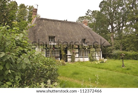 old english traditional thatched roof cottage #112372466