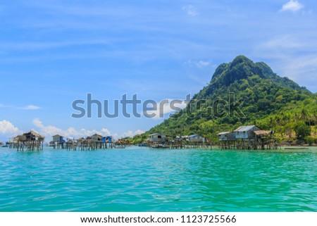 Beautiful landscapes view borneo sea gypsy water village in Bodgaya Mabul Island, Semporna Sabah, Malaysia. #1123725566
