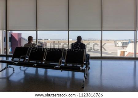 people waiting at airport #1123816766