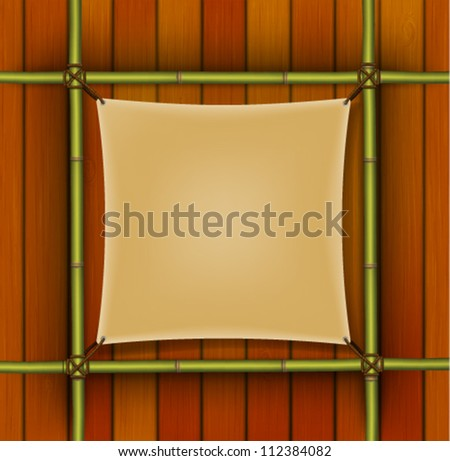 Bamboo frame with parchment banner on the wooden background #112384082
