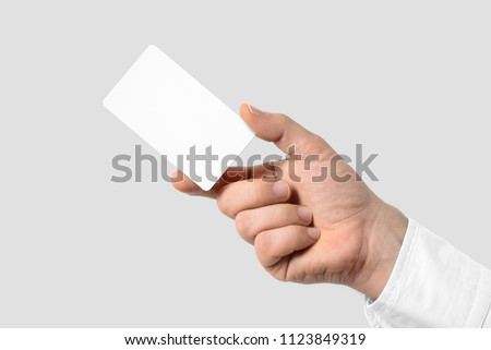 "Mockup of male hand holding a Business Card isolated on light grey background. Rounded corner, Standard US size 3.5""×2"""