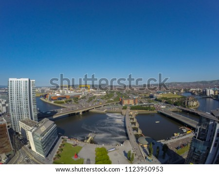 aerial view on river, bridge and buildings against clear blue sky in Belfast Northern Ireland  #1123950953
