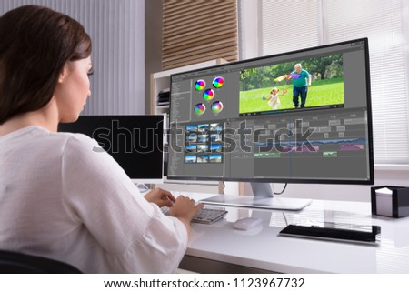 Young Female Editor Editing Video On Computer In Office #1123967732