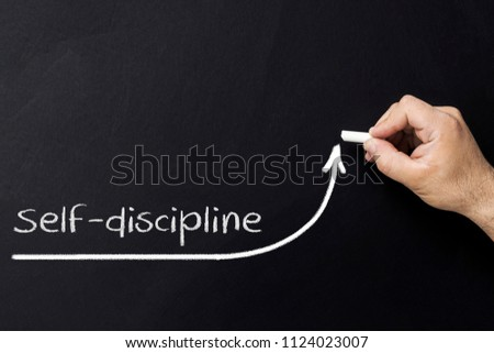 Self discipline concept. Hand with chalk drawing rising arrow. Discipline and self motivation #1124023007