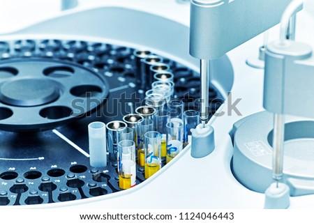 Closeup of a modern robotic machine for blood centrifugation and urinalysis. Hospital laboratories, automatic biochemical analyzer. #1124046443